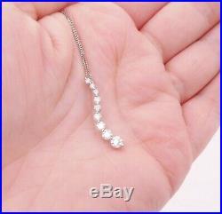 18ct gold 70 point diamond pendant on 9ct chain 9 stone