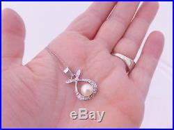 18ct gold cultured pearl diamond art deco design pendant on 9ct gold chain