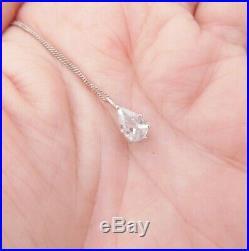 18ct gold diamond pendant on 9ct gold chain, pear drop