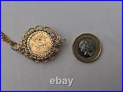 1911 22ct half sovereign mounted pendant with 9ct gold chain. 18.2 grams
