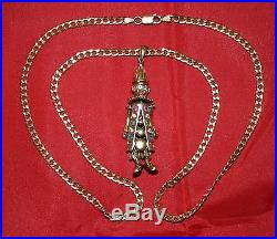 9ct Gold Articulated Clown pendant with Gemstone's On 24 Curb Chain 21.5g