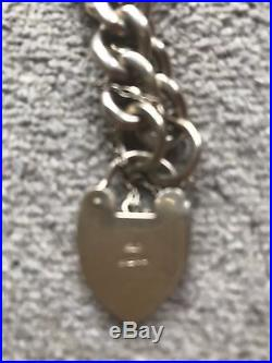 9ct Gold, Curb Chain Bracelet With Heart Padlock, 35.2 Grammes. Hallmarked