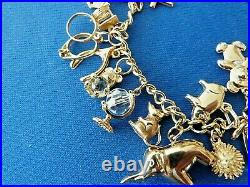 9ct Solid Hallmarked Gold Charm Bracelet 24 charms inc Padlock & chain 27.4 gm