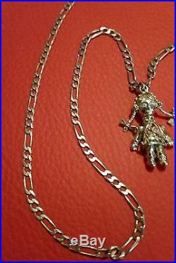 A Lovely 9ct gold Ragdoll on a lovely 9ct Gold 3 in 1 figaro chain
