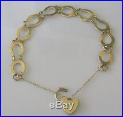 Vintage 9ct yellow gold multi horse shoe (9.9g) bracelet & safety chain